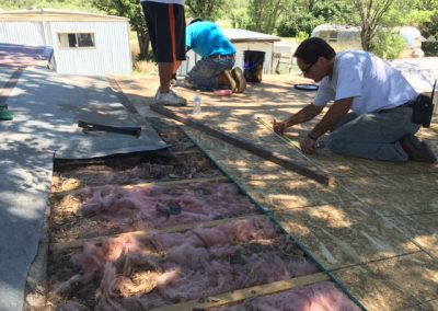 6 CHOP replaced a roof through home repair program. Volunteers Michael Quiroga and Stu Evans did the work.