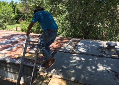 4 CHOP replaced a roof through home repair program. Volunteers Michael Quiroga and Stu Evans did the work.