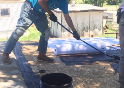 2 CHOP replaced a roof through home repair program. Volunteers Michael Quiroga and Stu Evans did the work.