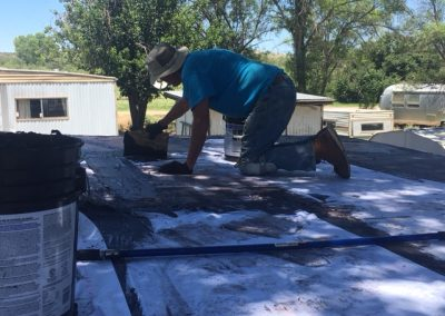 1 CHOP replaced a roof through home repair program. Volunteers Michael Quiroga and Stu Evans did the work.